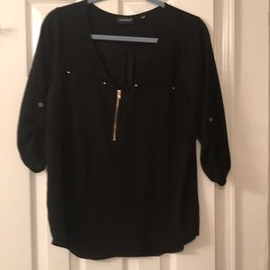 Blouse with gold accents
